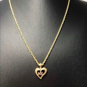 Vintage nina ricci Necklace it's gold plated.